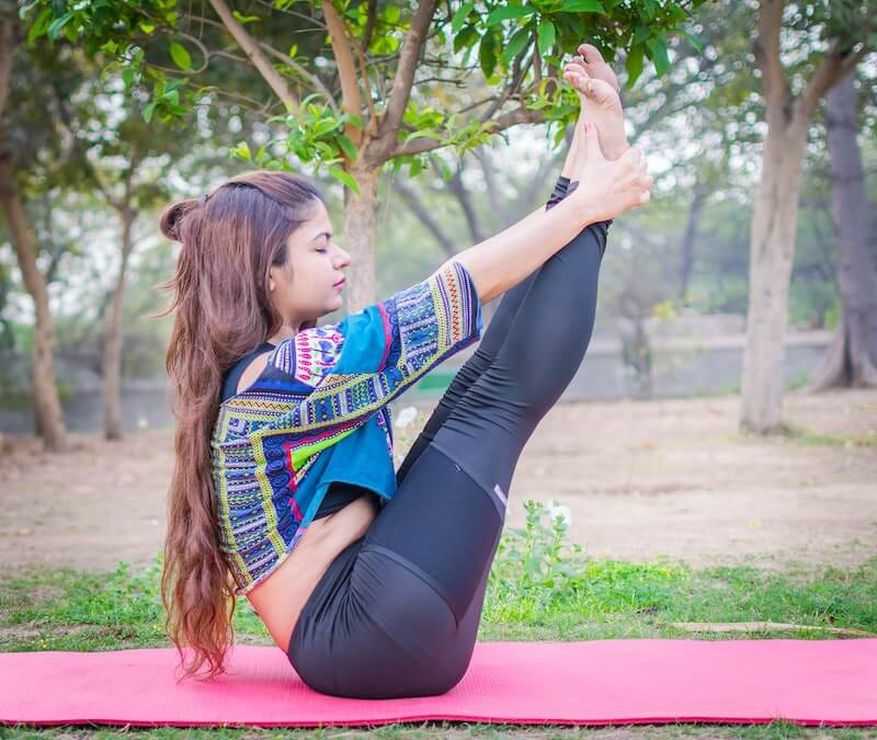 Woman on a mat in a yoga stretch